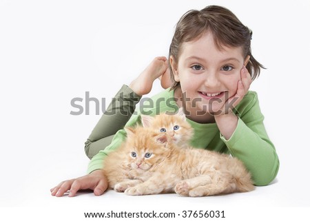 A cute little girl playing with baby cat - stock photo
