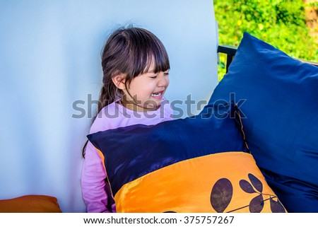 A cute little girl with sad expression and tears - stock photo
