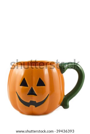 A cute little Halloween jack-o-lantern pumpkin mug, orange with green handle, isolated on white background, vertical with copy space - stock photo