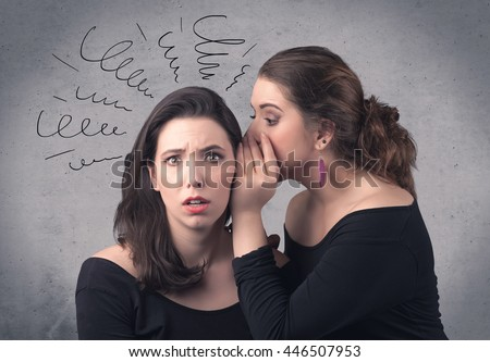 A cute teen caucasian girl telling secret things to her girlfriend dressed in black dress concept with drawn lines, curves, spirals on grey wall background. - stock photo