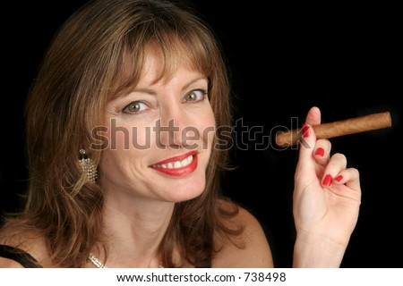 A cute woman smoking a big cigar. - stock photo