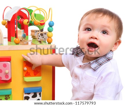 A cute young boy playing with his colorful toys isolated over white - stock photo