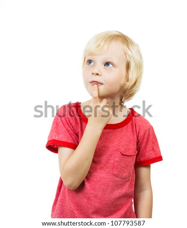 A cute young boy thinking and looking at copyspace - stock photo