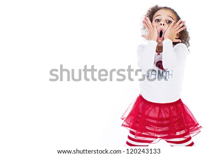 A cute young girl expressing shock and surprise with her comical expression. - stock photo