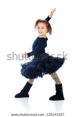 A cute young girl in a black dress having fun. - stock photo