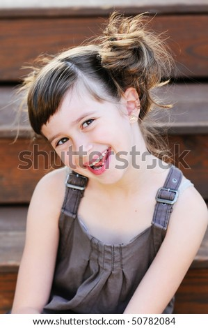 A cute young girl smiling - stock photo