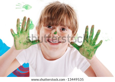 A cute young girl with paint on her hands - stock photo