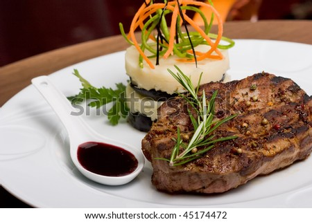A cutlet meat and Mashed Potato, selective focus on meat. - stock photo