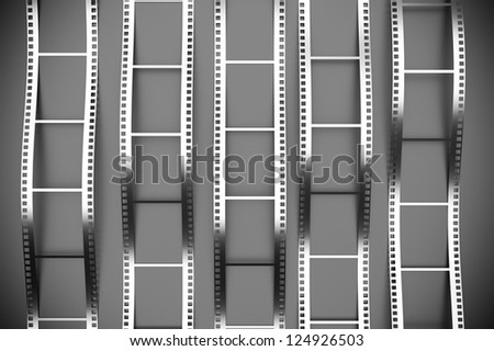 a 3d render of film reel background - stock photo