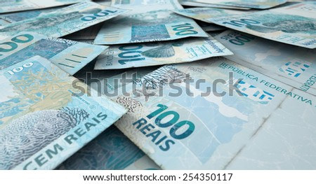A 3D rendering of a  macro close-up view of a messy scattered pile of brazilian real banknotes - stock photo