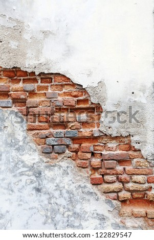 A damaged brick wall with blank space for text. - stock photo