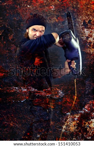 a dangerous man with a chainsaw and an evil eye - stock photo