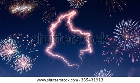 A dark night sky with a sparkling red firecracker in the shape of Colombia composed into.(series) - stock photo