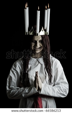 a dark scary version of the folklore character lucia - stock photo