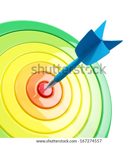 A dart hits the target with a color scale based on the distance from the center - stock photo