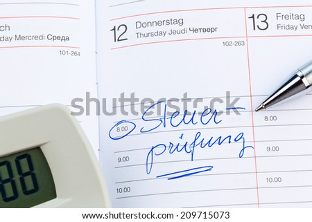 a date is entered on a calendar: tax audit - stock photo
