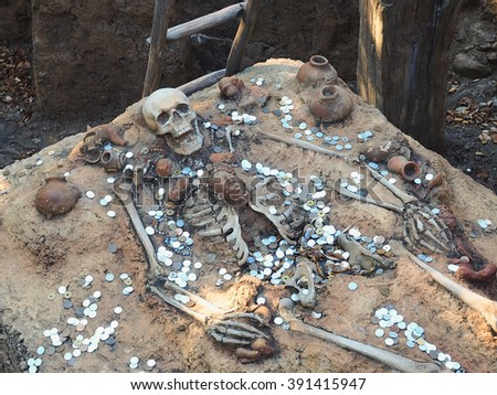a dead body and treasure - stock photo