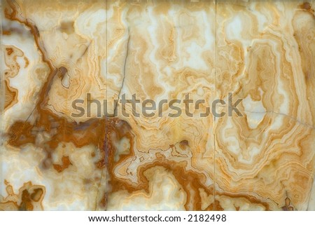 A decorative polished marble wall; smooth texture - stock photo