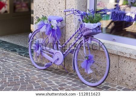 a decorative, purple bike - stock photo