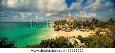 A 110-degree panoramic image of the main temple structure and Gulf of Mexico in the ancient Mayan city at Tulum, Mexico. - stock photo