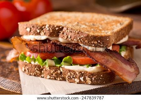 A delicious bacon, lettuce, and tomato blt sandwich. - stock photo