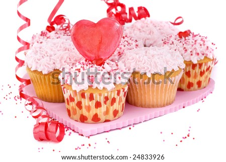 A delicious batch of pink and red Valentine's cupcakes with red candy heart and sprinkles - stock photo