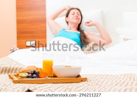 a delicious breakfast in bed for the girl - stock photo