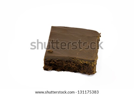 A delicious brownie covered in fudge isolated against white with plenty of room for copy - stock photo