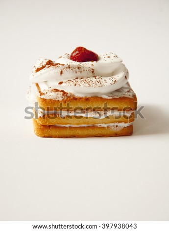 a delicious cake with a cherry - stock photo
