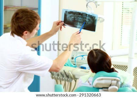 A dentist holding an x-ray  - stock photo
