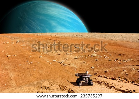 A depiction of a rover exploring an airless moon. An water covered world rises over the horizon. Elements of this image furnished by NASA.  - stock photo