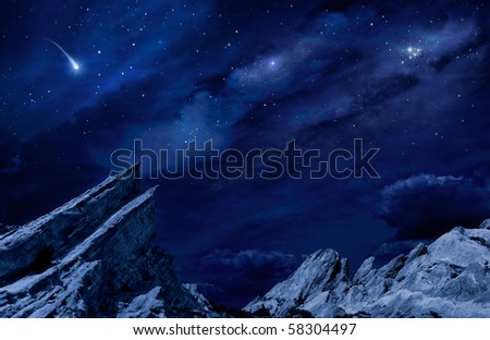 A desert landscape at night with moonlight and stars. - stock photo