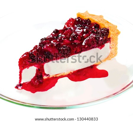 A dessert consisting of a mixture based on soft, fresh cheese, eggs, and sugar on a crust of  sponge cake. - stock photo