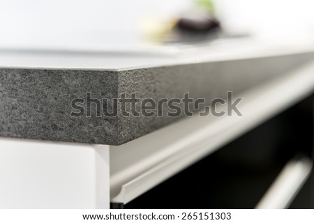 A detail close up image of a stylish kitchen counter top - stock photo