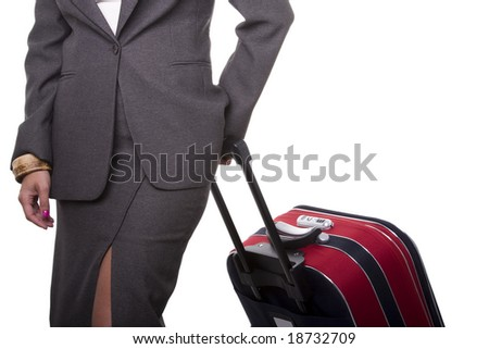a detail of a businesswoman pushing her baggage - stock photo