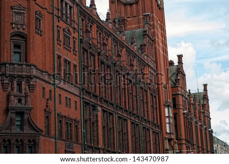 A detail of an historical building in the heart of Manchester city center. This red brick and terracotta building was built in 1891-1895 and is known as Refuge Assurance Building or Refuge Building. - stock photo