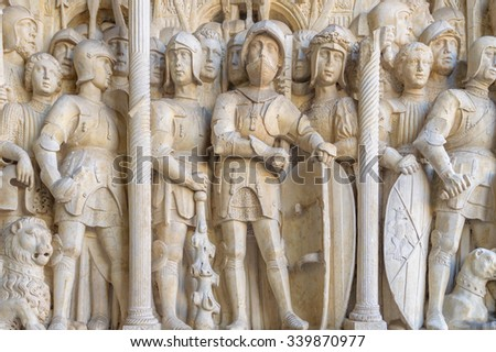 A detail of an old historic medieval stone carving with knights and soldiers on the Triumphal Arch in Naples, Italy - stock photo