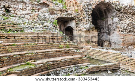 A detail of the ruins of Odeon, the ancient greek theater of taormina, in sicily, landscape cut. - stock photo