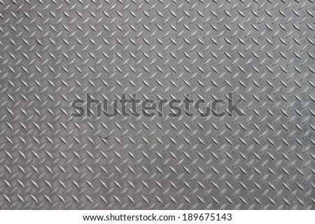 A diagonal pattern on gray metal - stock photo