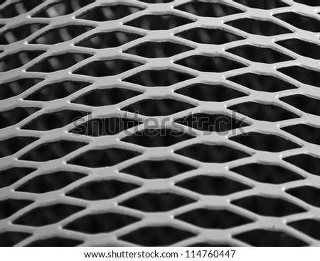 A diamond pattern on a bench seat in the park - stock photo