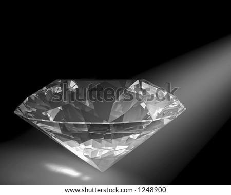 A diamond sparkles in a white spot light. - stock photo