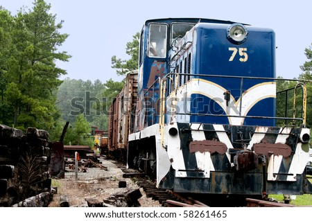 A Diesel Train Engine on railroad train tracks. - stock photo