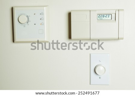 A digital climate control on the house - stock photo
