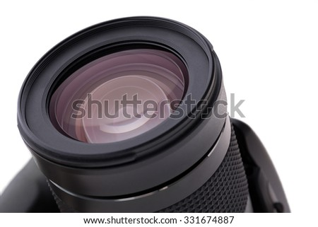 A digital reflex camera as an isolated object - stock photo