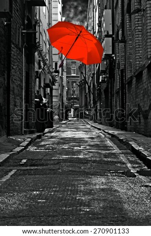 A digitally constructed painting of a colorful umbrella in a dark back street alley - stock photo
