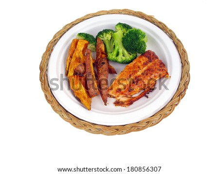 a dinner of salmon, sweet potato fries and brocolli isolated on white background - stock photo