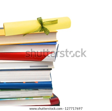 A diploma over  books. Isolated on white. - stock photo