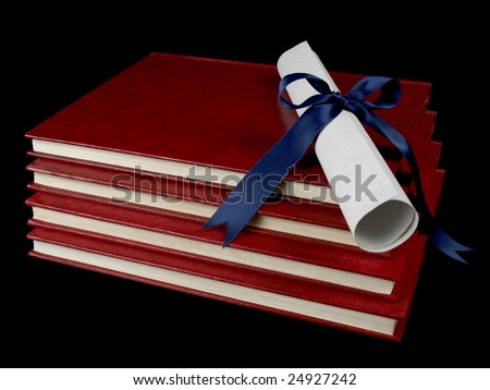A diploma with a blue ribbon over several books. Isolated on black. - stock photo