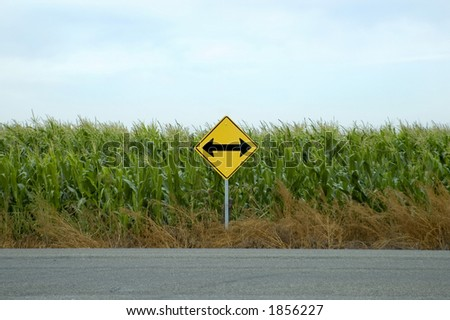 A directional rural road sign. - stock photo