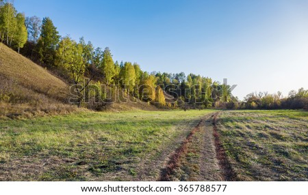 A dirt road in the countryside - stock photo